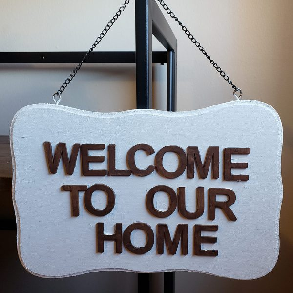 Wooden sign welcome to our home